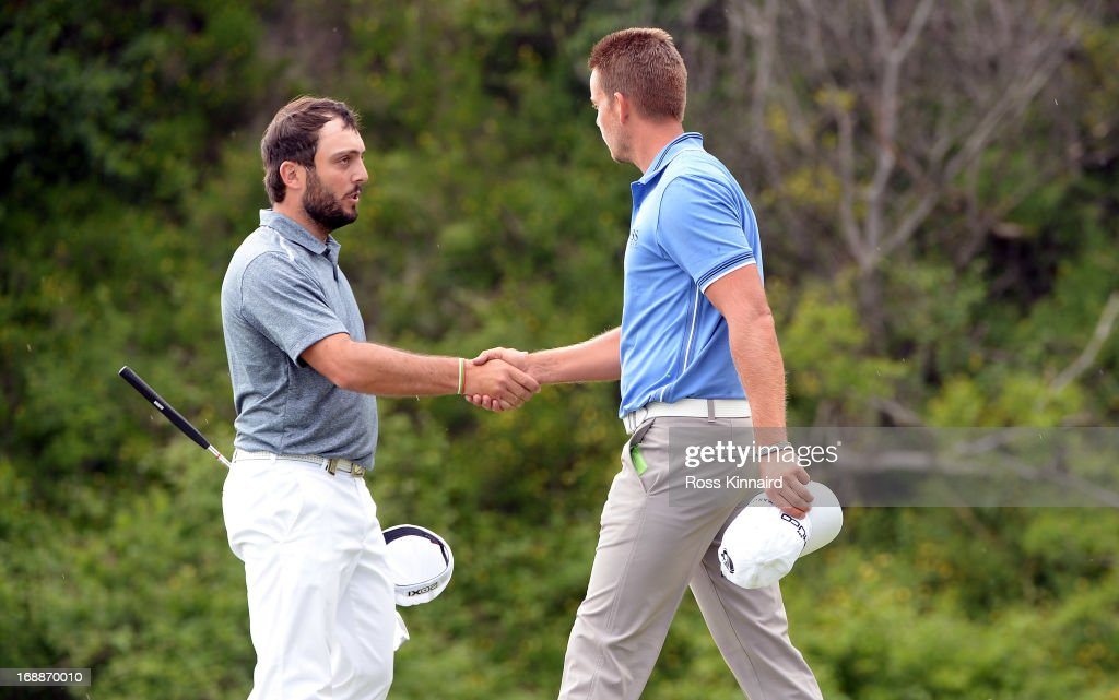 Francesco Molinar of Italy shakes hands with Henrik Stenson of Sweden after winning 2&1 on day one of the Volvo World Match Play Championship at Thracian Cliffs Golf & Beach Resort on May 16, 2013 in Kavarna, Bulgaria.