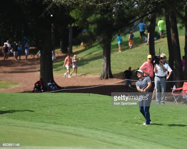 Francesco Molinari hits an approach shot to the 10th green during the final round of the PGA Championship on August 13 2017 at Quail Hollow Golf Club...