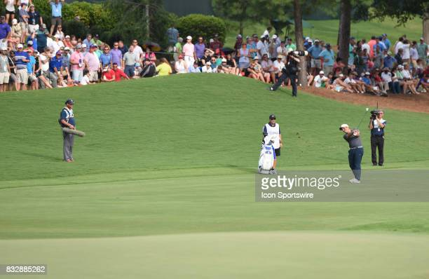 Francesco Molinari hits an approach shot to the 18th green during the final round of the PGA Championship on August 13 2017 at Quail Hollow Golf Club...