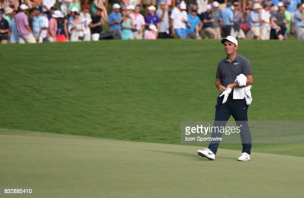 Francesco Molinari looks over the 18th green during the final round of the PGA Championship on August 13 2017 at Quail Hollow Golf Club in Charlotte...
