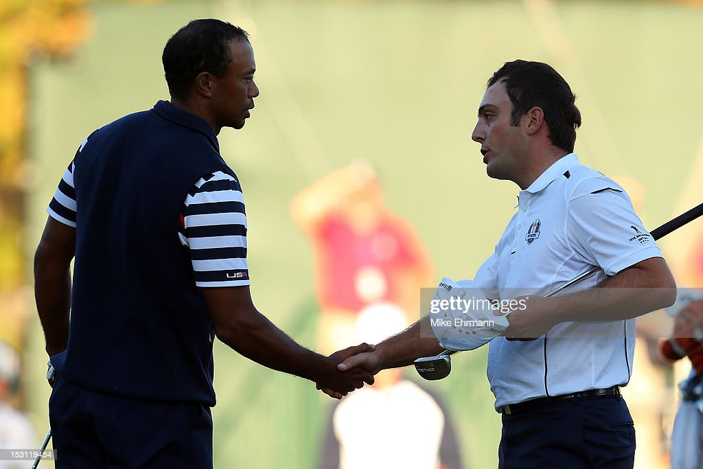 <a gi-track='captionPersonalityLinkClicked' href=/galleries/search?phrase=Francesco+Molinari&family=editorial&specificpeople=637481 ng-click='$event.stopPropagation()'>Francesco Molinari</a> of Europe (R) shakes hands with <a gi-track='captionPersonalityLinkClicked' href=/galleries/search?phrase=Tiger+Woods&family=editorial&specificpeople=157537 ng-click='$event.stopPropagation()'>Tiger Woods</a> of the USA on the 18th green after halving his match with Woods during the Singles Matches for The 39th Ryder Cup at Medinah Country Club on September 30, 2012 in Medinah, Illinois.