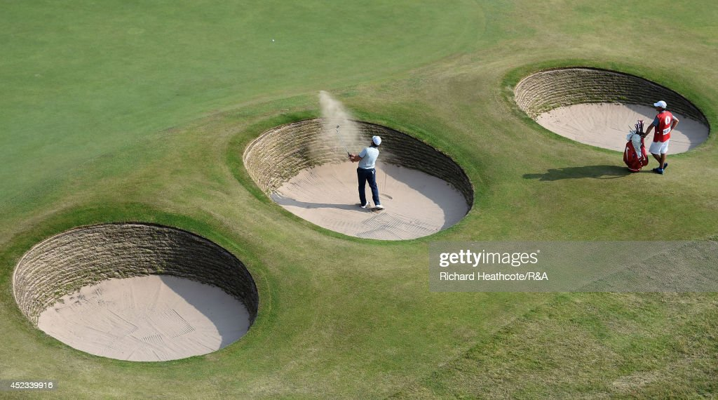 <a gi-track='captionPersonalityLinkClicked' href=/galleries/search?phrase=Francesco+Molinari&family=editorial&specificpeople=637481 ng-click='$event.stopPropagation()'>Francesco Molinari</a> of Italy hits a shot from a greenside bunker on the 18th green during the second round of The 143rd Open Championship at Royal Liverpool on July 18, 2014 in Hoylake, England.