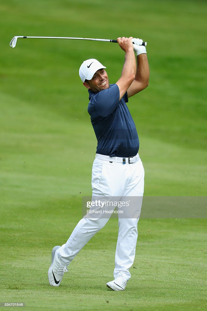 <a gi-track='captionPersonalityLinkClicked' href=/galleries/search?phrase=Francesco+Molinari&family=editorial&specificpeople=637481 ng-click='$event.stopPropagation()'>Francesco Molinari</a> of Italy hits his 2nd shot on the 12th hole during day two of the BMW PGA Championship at Wentworth on May 27, 2016 in Virginia Water, England.