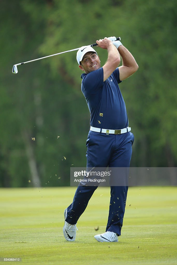 <a gi-track='captionPersonalityLinkClicked' href=/galleries/search?phrase=Francesco+Molinari&family=editorial&specificpeople=637481 ng-click='$event.stopPropagation()'>Francesco Molinari</a> of Italy hits his 2nd shot on the 9th hole during day one of the BMW PGA Championship at Wentworth on May 26, 2016 in Virginia Water, England.