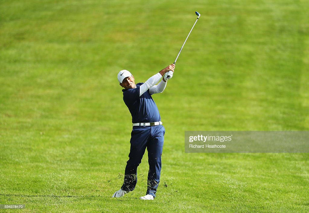 <a gi-track='captionPersonalityLinkClicked' href=/galleries/search?phrase=Francesco+Molinari&family=editorial&specificpeople=637481 ng-click='$event.stopPropagation()'>Francesco Molinari</a> of Italy hits his approach on the 4th hole during day one of the BMW PGA Championship at Wentworth on May 26, 2016 in Virginia Water, England.