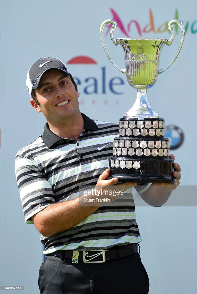 <a gi-track='captionPersonalityLinkClicked' href=/galleries/search?phrase=Francesco+Molinari&family=editorial&specificpeople=637481 ng-click='$event.stopPropagation()'>Francesco Molinari</a> of Italy holds the trophy after winning the Open de Espana at Real Club de Golf de Sevilla on May 6, 2012 in Seville, Spain
