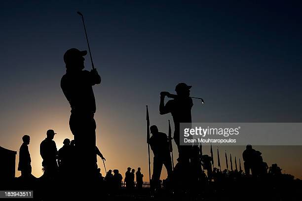 Francesco Molinari of Italy looks on after he hit his practice shot on the driving range during the first round of the Portugal Masters at Oceanico...