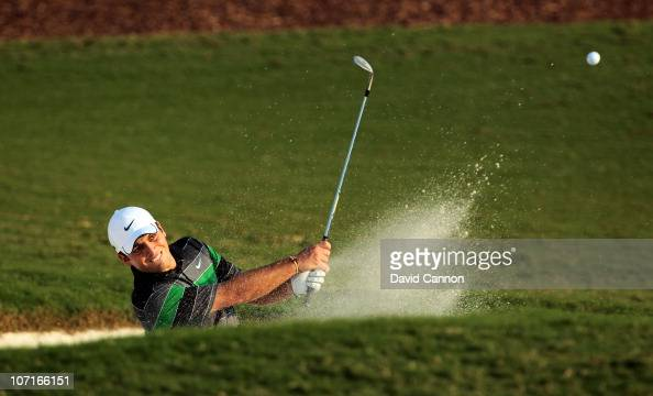 Francesco Molinari of Italy plays his fourth shot at the par 5 18th hole during the third round of the Dubai World Championship on the Earth Course...