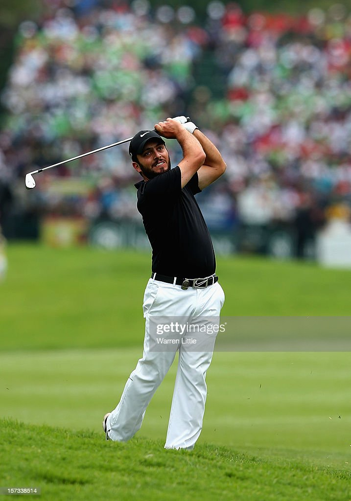 Francesco Molinari of Italy plays his second shot into the first green during the final round of the Nedbank Golf Challenge at the Gary Player Country Club on December 2, 2012 in Sun City, South Africa.