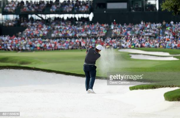 Francesco Molinari of Italy plays his second shot on the par 4 18th hole during the final round of the 2017 PGA Championship at Quail Hollow on...