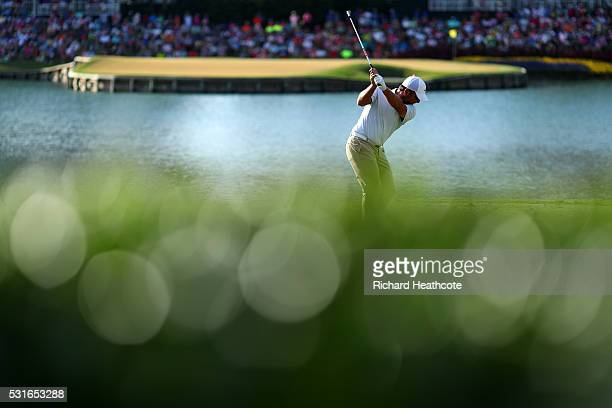 Francesco Molinari of Italy plays his shot from the 17th tee during the final round of THE PLAYERS Championship at the Stadium course at TPC Sawgrass...