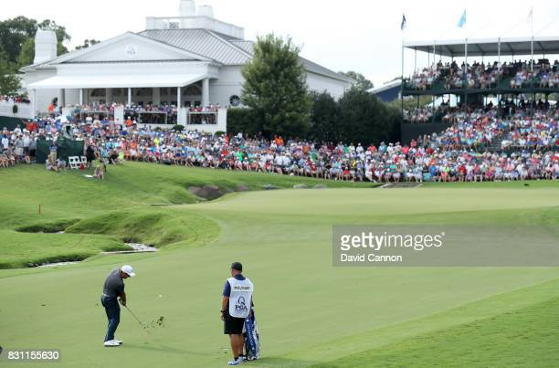 Francesco Molinari of Italy plays his third shot on the par 4 18th hole during the final round of the 2017 PGA Championship at Quail Hollow on August...