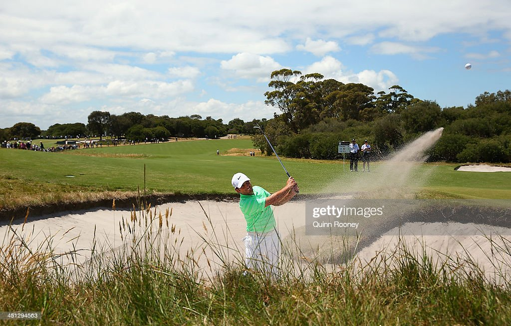 <a gi-track='captionPersonalityLinkClicked' href=/galleries/search?phrase=Francesco+Molinari&family=editorial&specificpeople=637481 ng-click='$event.stopPropagation()'>Francesco Molinari</a> of Italy plays out of the bunker during day two of the World Cup of Golf at Royal Melbourne Golf Course on November 22, 2013 in Melbourne, Australia.