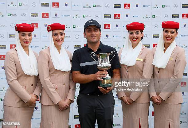 Francesco Molinari of Italy poses with Emirates girls after winning the Italian Open at Golf Club Milano Parco Reale di Monza on September 18 2016 in...