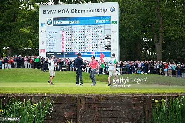 Francesco Molinari of Italy shakes hands with ByeongHun An of South Korea on the 18th green during day 3 of the BMW PGA Championship at Wentworth on...