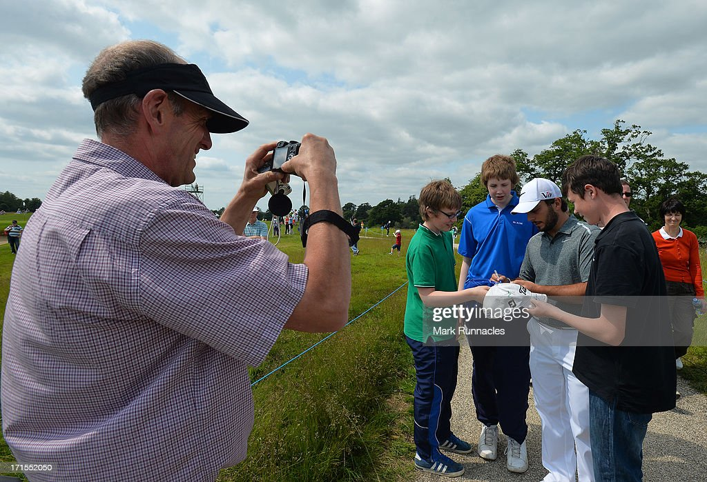 <a gi-track='captionPersonalityLinkClicked' href=/galleries/search?phrase=Francesco+Molinari&family=editorial&specificpeople=637481 ng-click='$event.stopPropagation()'>Francesco Molinari</a> (C) of Italy signs autographs at the 6th green during the pro-am event prior to the Irish Open at Carton House Golf Club on June 26, 2013 in Maynooth, Ireland.