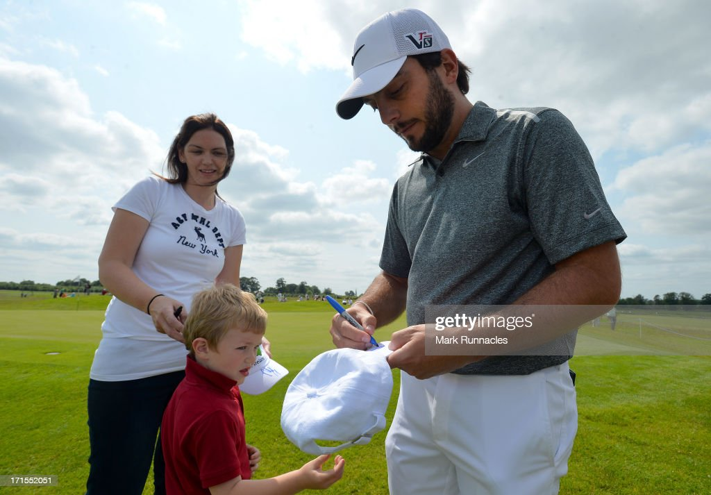 <a gi-track='captionPersonalityLinkClicked' href=/galleries/search?phrase=Francesco+Molinari&family=editorial&specificpeople=637481 ng-click='$event.stopPropagation()'>Francesco Molinari</a> (R) of Italy signs autographs at the 6th green during the pro-am event prior to the Irish Open at Carton House Golf Club on June 26, 2013 in Maynooth, Ireland.