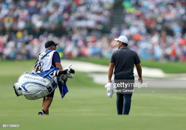 Francesco Molinari of Italy walks up the fairway on the par 4 18th hole during the final round of the 2017 PGA Championship at Quail Hollow on August...