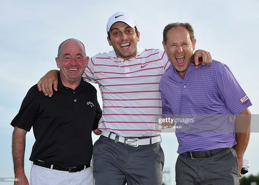 <a gi-track='captionPersonalityLinkClicked' href=/galleries/search?phrase=Francesco+Molinari&family=editorial&specificpeople=637481 ng-click='$event.stopPropagation()'>Francesco Molinari</a> of Italy with his coach Denis Pugh (left) and short game coach <a gi-track='captionPersonalityLinkClicked' href=/galleries/search?phrase=Mark+Roe&family=editorial&specificpeople=615438 ng-click='$event.stopPropagation()'>Mark Roe</a> (right) during the pro-am prior to the start of the Portugal Masters at the Victoria golf course at Villamoura on October 10, 2012 in Faro, Portugal.
