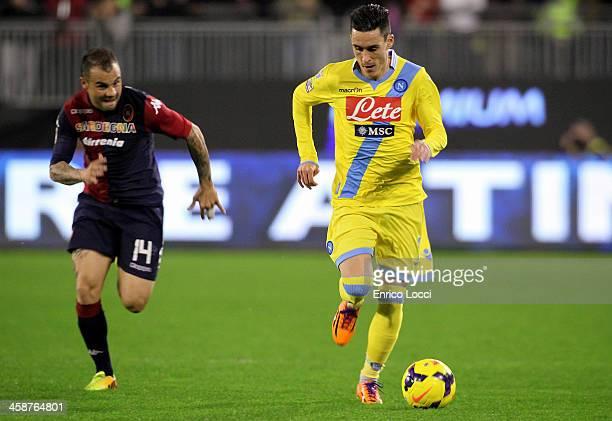Francesco Pisano of Cagliari competes with Higuain Gonzalo of Napoli during the Serie A match between Cagliari Calcio and SSC Napoli at Stadio...