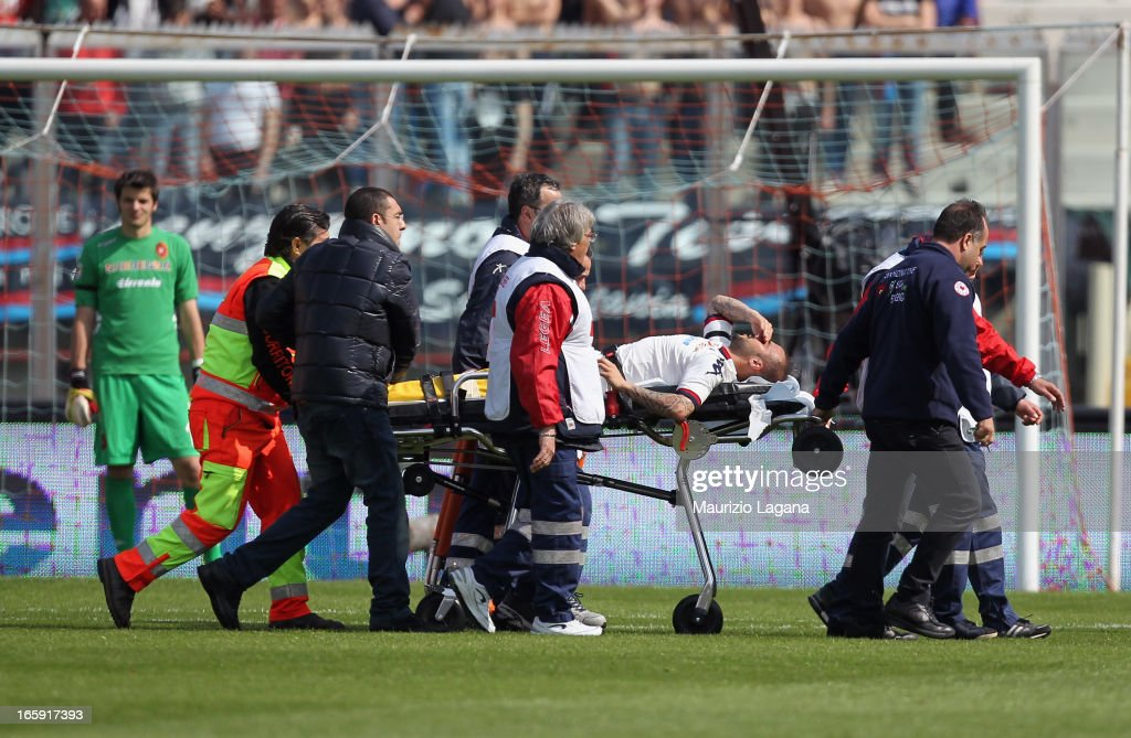 Francesco Pisano of Cagliari is carried off the pitch after suffering an injury during the Serie A match between Calcio Catania and Cagliari Calcio...