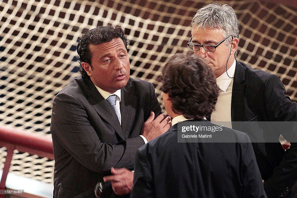 <a gi-track='captionPersonalityLinkClicked' href=/galleries/search?phrase=Francesco+Schettino&family=editorial&specificpeople=8797246 ng-click='$event.stopPropagation()'>Francesco Schettino</a> (L) speaks with his lawyers before the trial on July 17, 2013 in Grosseto, Italy. The trial of the captain of the Costa Concordia cruise ship, Capt <a gi-track='captionPersonalityLinkClicked' href=/galleries/search?phrase=Francesco+Schettino&family=editorial&specificpeople=8797246 ng-click='$event.stopPropagation()'>Francesco Schettino</a>, opened on July 9, and was adjourned to today. Schettino, 52, faces charges of manslaughter and abandoning ship, after the luxury liner ran aground off the island of Giglio in January, 2012.