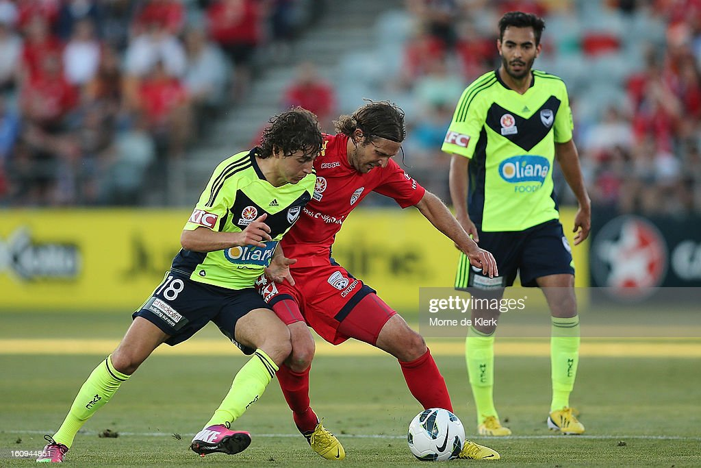 Francesco Stella of Melbourne is tackled by Jonathan McKain (R) of Adelaide during the round 20 A-League match between Adelaide United and the Melbourne Victory at Hindmarsh Stadium on February 8, 2013 in Adelaide, Australia.