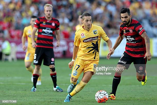 Francesco Stella of the Mariners controls the ball ahead of the Wanderers defence during the round 16 ALeague match between the Central Coast...
