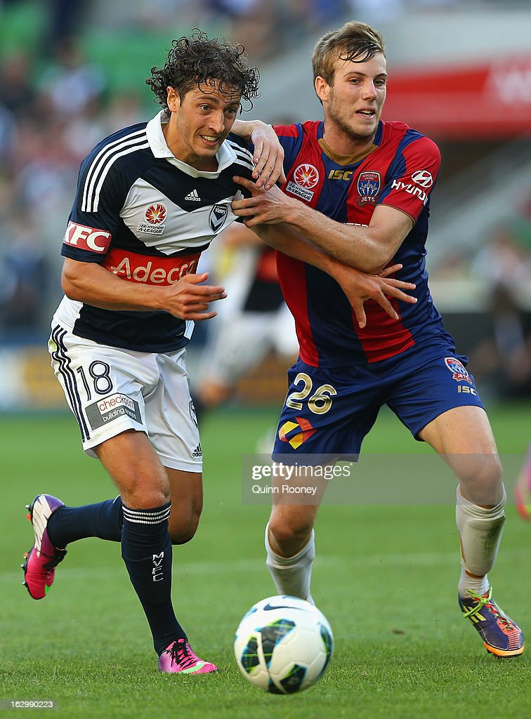 Francesco Stella of the Victory and Andrew Hoole of the Jets contest for the ball during the round 23 A-League match between the Melbourne Victory and the Newcastle Jets at AAMI Park on March 3, 2013 in Melbourne, Australia.