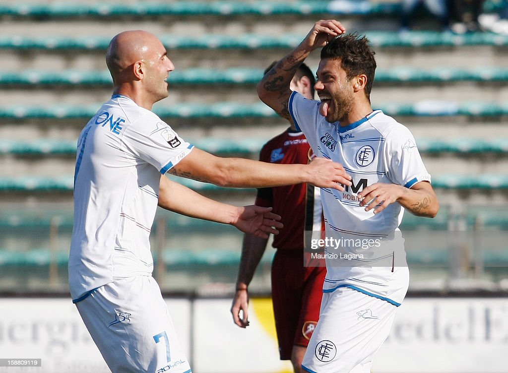 Francesco Tavano of Empoli celebrates his team's second goal with his teammate <a gi-track='captionPersonalityLinkClicked' href=/galleries/search?phrase=Massimo+Maccarone&family=editorial&specificpeople=204389 ng-click='$event.stopPropagation()'>Massimo Maccarone</a> during the Serie A match between Reggina Calcio and Empoli FC at Stadio Oreste Granillo on December 30, 2012 in Reggio Calabria, Italy.