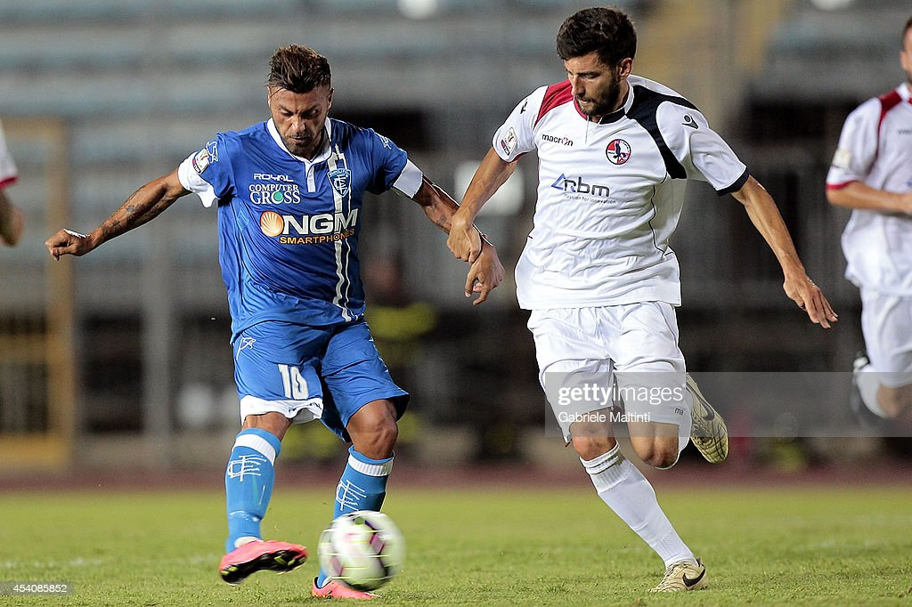 Francesco Tavano of Empoli Fc battles for the ball with Giordano Maccarrone of L'Aquila Calcio during the TIM Cup match between Empoli FC and L'Aquila Calcio at Stadio Carlo Castellani on August 24, 2014 in Empoli, Italy.