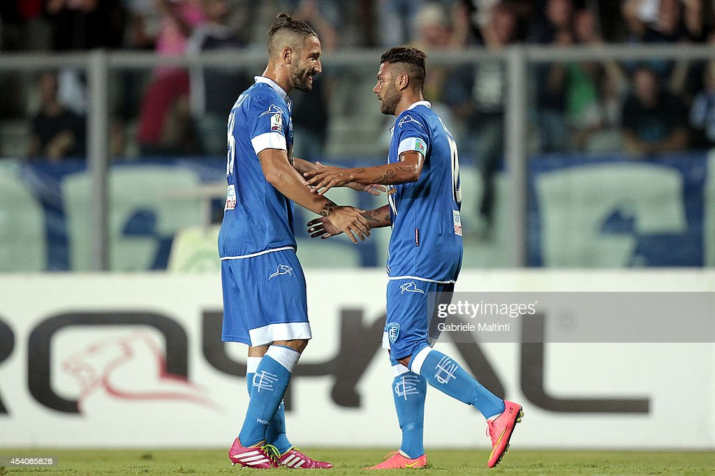 Francesco Tavano (R) of Empoli FC celebrates after scoring a goal during the TIM Cup match between Empoli FC and L'Aquila Calcio at Stadio Carlo Castellani on August 24, 2014 in Empoli, Italy.
