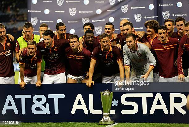 Francesco Totti and AS Roma pose with the trophy after defeating the MLS AllStars 31 to win the 2013 Major League Soccer All Star Game at Sporting...
