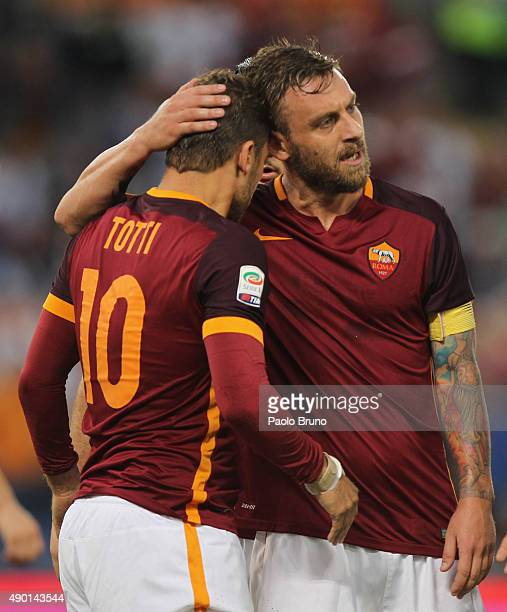 Francesco Totti and Daniele De Rossi of AS Roma celebrate after the team's fourth goal scored by Mohamed Salah during the Serie A match between AS...