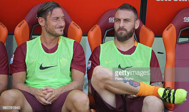 Francesco Totti and Daniele De Rossi of AS Roma look on during the Serie A match between AS Roma and Udinese Calcio at Olimpico Stadium on August 20...