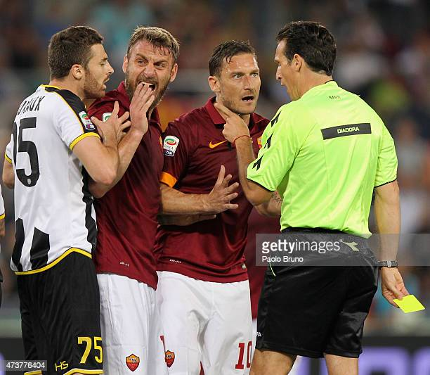 Francesco Totti and Daniele De Rossi of AS Roma protest with the referee Luca Banti during the Serie A match between AS Roma and Udinese Calcio at...