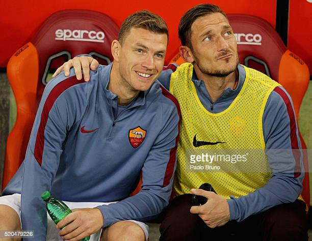 Francesco Totti and Edin Dzeko of AS Roma look on during the Serie A match between AS Roma and Bologna FC at Stadio Olimpico on April 11 2016 in Rome...