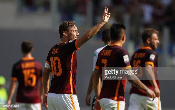 Francesco Totti celebrates with his teammates of AS Roma celebrates after scoring their first goal during the Serie A match between AS Roma and US...