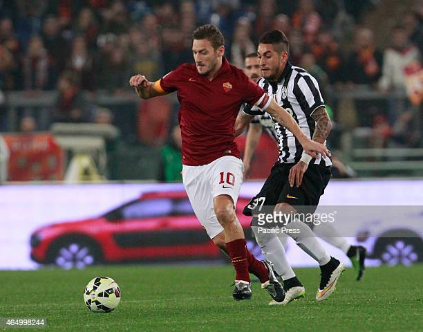 Francesco Totti competes with Roberto Pereyra during the Italian Serie A soccer match between AS Roma and Juventus FC in Olympic Stadium during the...