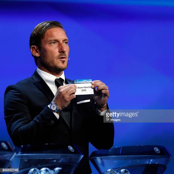 Francesco Totti draws Bayern Munich during the UEFA Champions League Group stage draw ceremony at the Grimaldi Forum Monte Carlo in Monaco on August...
