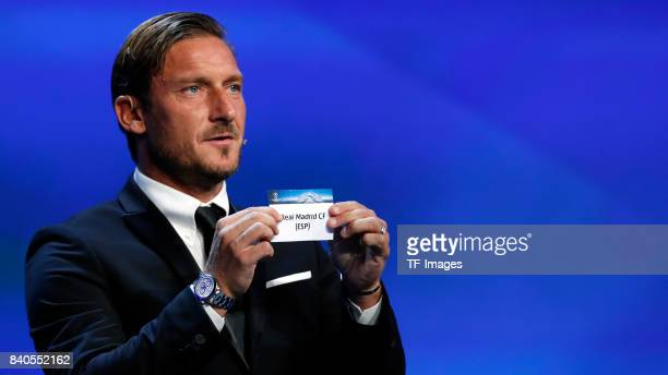 Francesco Totti draws Bayern Munich Real Madrid during the UEFA Champions League Group stage draw ceremony at the Grimaldi Forum Monte Carlo in...