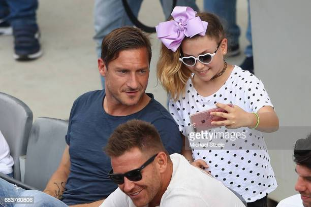 Francesco Totti legend of AS Roma poses for a 'selfie' during the men's second round match between Fernando Verdasco of Spain and David Goffin of...