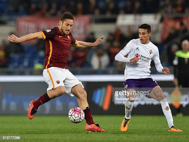 Francesco Totti of AS Roma and Cristian Tello of ACF Fiorentina in action during the Serie A match between AS Roma and ACF Fiorentina at Stadio...