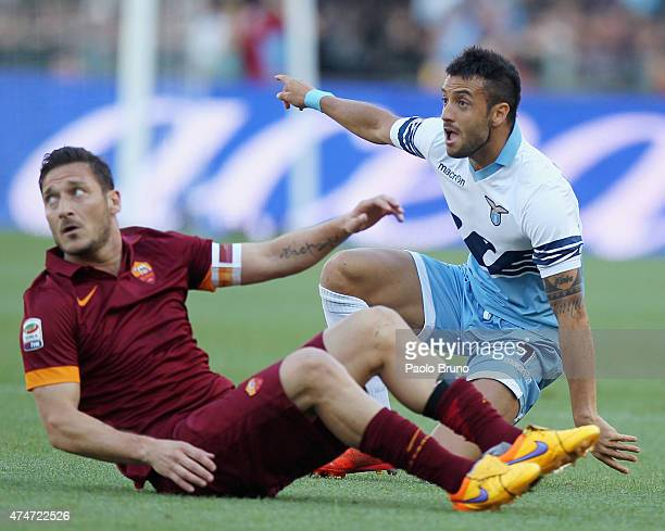 Francesco Totti of AS Roma and Felipe Anderson of SS Lazio react during the Serie A match between SS Lazio and AS Roma at Stadio Olimpico on May 25...
