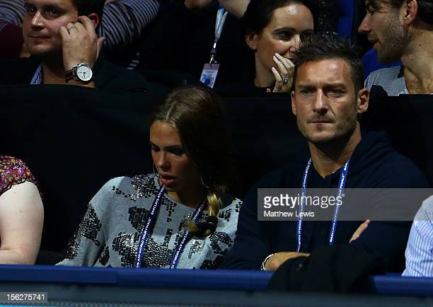 Francesco Totti of AS Roma and his wife Ilary Blasi attend the men's singles final match between Roger Federer of Switzerland and Novak Djokovic of...
