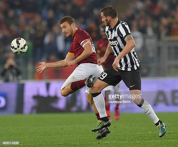 Francesco Totti of AS Roma and Leonardo Bonucci of Juventus FC in action during the Serie A match between AS Roma and Juventus FC at Stadio Olimpico...