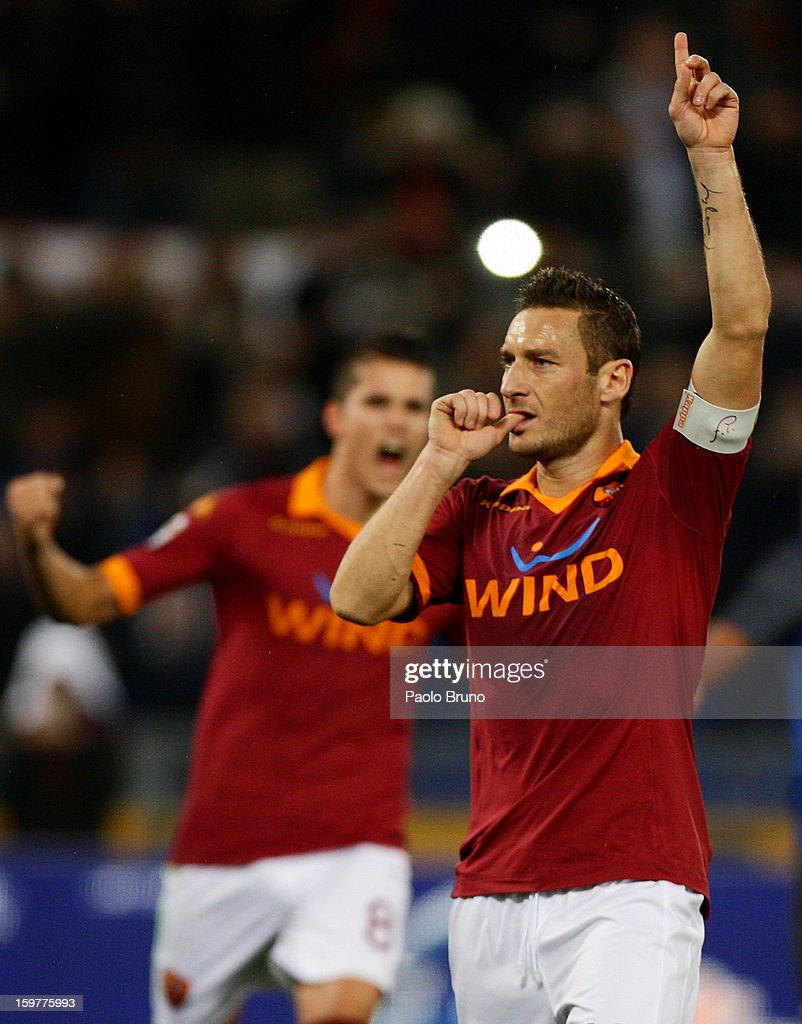 <a gi-track='captionPersonalityLinkClicked' href=/galleries/search?phrase=Francesco+Totti&family=editorial&specificpeople=208985 ng-click='$event.stopPropagation()'>Francesco Totti</a> of AS Roma celebrates after scoring the opening goal from the penalty spot during the Serie A match between AS Roma and FC Internazionale Milano at Stadio Olimpico on January 20, 2013 in Rome, Italy.