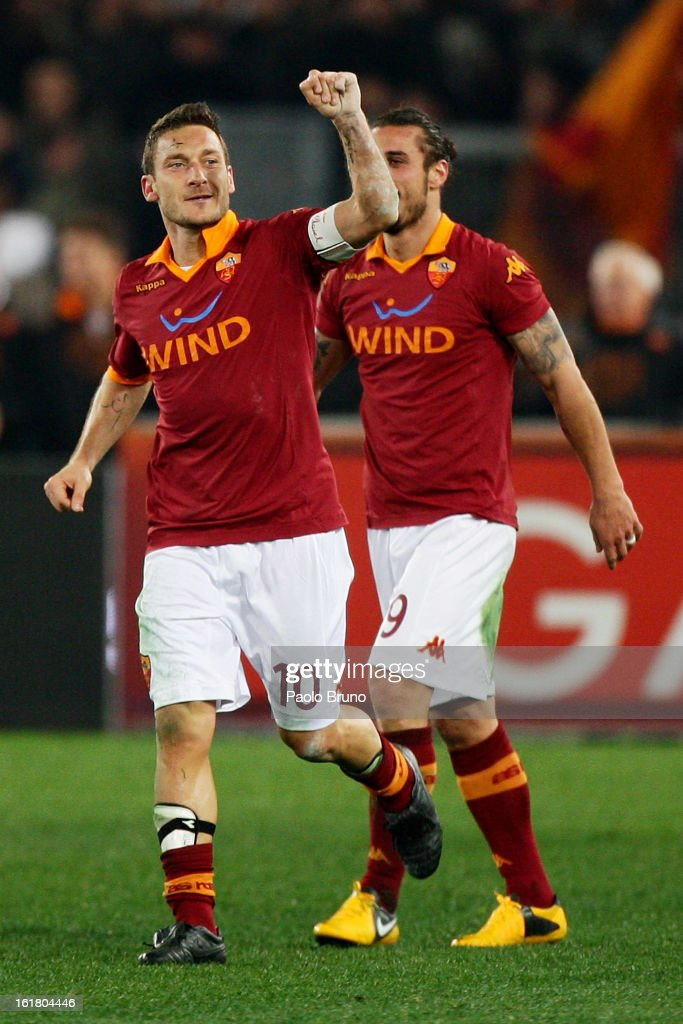 <a gi-track='captionPersonalityLinkClicked' href=/galleries/search?phrase=Francesco+Totti&family=editorial&specificpeople=208985 ng-click='$event.stopPropagation()'>Francesco Totti</a> (L) of AS Roma celebrates after scoring the opening goal of the Serie A match between AS Roma and Juventus FC at Stadio Olimpico on February 16, 2013 in Rome, Italy.