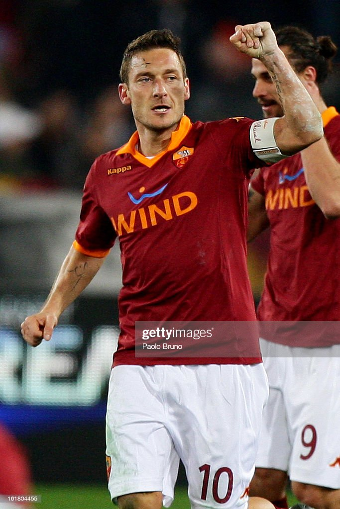 Francesco Totti of AS Roma celebrates after scoring the opening goal of the Serie A match between AS Roma and Juventus FC at Stadio Olimpico on February 16, 2013 in Rome, Italy.