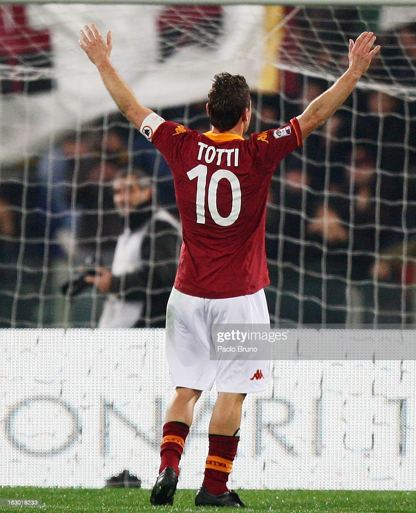 Francesco Totti of AS Roma celebrates after scoring the opening goal from the penalty spot during the Serie A match between AS Roma and Genoa CFC at Stadio Olimpico on March 3, 2013 in Rome, Italy.